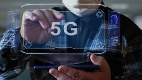 Old man shows hologram with text 5G