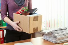 Unrecognizable employee with collected in box Stock Images