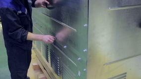 Unrecognizable employee put the screws in holes, screwing, tightening by hand. HD stock video