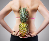 Unrecognizable fit woman with pineapple royalty free stock photography