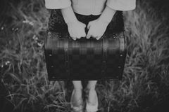 Unrecognizable girl holding retro vintage suitcase Stock Photo