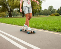 Unrecognizable girl skating on a longboard Royalty Free Stock Photography