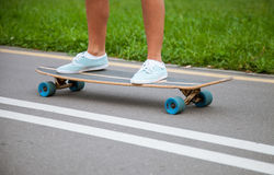 Unrecognizable girl skating on a longboard Royalty Free Stock Photo