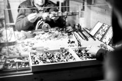 Unrecognizable glass blower preparing traditional Christmas toys souvenirs at the Christmas Market Stock Image