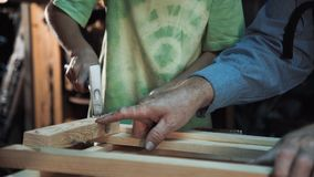 Carpenter and grandson in shop stock photo