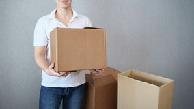 Unrecognizable guy keep cardboard boxex in his hand stock image