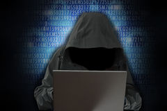 Unrecognizable hacker in front of computer – cyber crime concept Royalty Free Stock Image