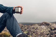 Unrecognizable Hiker Man Holding Cup In His Hand. Hiking Advent. Unrecognizable Traveler Man Holding Cup In His Hand. Hiking Adventure Camping Tourism Concept stock images