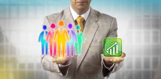 Manager Motivating Cultural Diverse Work Team. Unrecognizable HR manager is balancing a multicolored work team of five versus an upward growth trend icon Stock Photo
