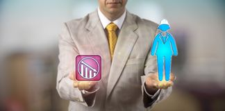 Man Equating Female Worker With Downward Swing. Unrecognizable HR manager equating a female worker wearing a helmet with negative growth. HR concept for downward Royalty Free Stock Photography