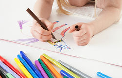 Unrecognizable little girl drawing Royalty Free Stock Photos