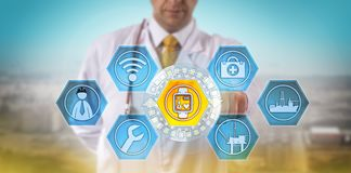 Doctor Tracking Pulse Of Remote Offshore Engineer. Unrecognizable male doctor monitoring the pulse rate of a remote offshore engineer. Health care and safety Royalty Free Stock Photography