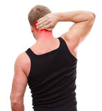 Unrecognizable male with neck pain on white. One handsome Caucasian man in black t-shirt with neck pain isolated on white background Royalty Free Stock Image