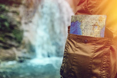 Unrecognizable Male Traveler Standing With Travel Map In Pocket Closeup Hiking Travel Tourism Concept royalty free stock photography