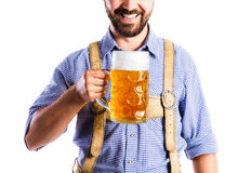 Unrecognizable man in bavarian clothes holding mug of beer Stock Images