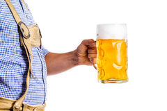 Unrecognizable man in bavarian clothes holding mug of beer Royalty Free Stock Photography