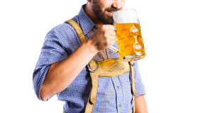 Unrecognizable man in bavarian clothes holding mug of beer Stock Photography