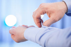 Unrecognizable man buttoning cuff Stock Photography