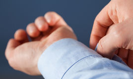 Unrecognizable man buttoning cuff Stock Photos