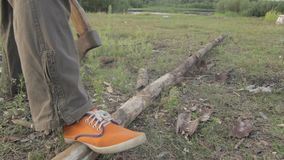 Unrecognizable man chopping woods outdoors stock footage