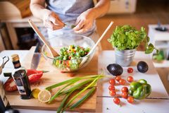 Unrecognizable man cooking. A man making vegetable salad Stock Photo