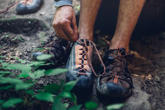 Unrecognizable Man Dresses Climbing Shoes For Climbing. Extreme Hobby Outdoor Activity Concept stock photography