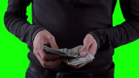 Unrecognizable man hands with money, counting, showing dollars on chromakey. Close up. stock video footage