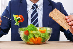 Unrecognizable man has healthy business lunch in modern office Royalty Free Stock Photos