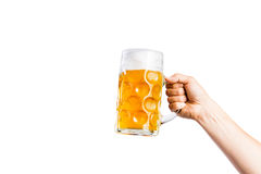 Unrecognizable man holding a beer mug, studio shot. Hand of unrecognizable men holding a beer mug. Oktoberfest. Studio shot on white background, isolated. Copy Stock Photo