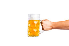 Unrecognizable man holding a beer mug, studio shot. Hand of unrecognizable men holding a beer mug. Oktoberfest. Studio shot on white background, isolated. Copy Stock Images