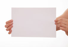 Unrecognizable man holding an empty sheet of paper Stock Images