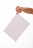 Unrecognizable man holding an empty sheet of paper Royalty Free Stock Photos