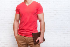 Unrecognizable Man Holding Tablet Computer Stand Over Wall Stock Photos
