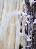 A Unrecognizable man ice climbing at Finland stock photo