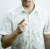 Unrecognizable man indicates his finger Stock Images