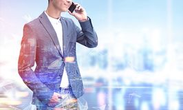 Unrecognizable man on phone, blurred city Stock Images