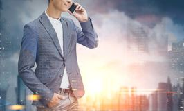 Unrecognizable man on phone, morning city Stock Photo