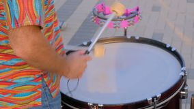 Man playing ethnic drum on street. Unrecognizable man playing ethnic percussion drum musical instrument on street - close up shot of drummer hands. Street music stock video