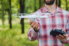 Unrecognizable man running drone with camera Royalty Free Stock Image