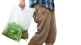Unrecognizable man select vegetable in supermarket.  Royalty Free Stock Photo