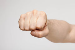 Unrecognizable man showing a strong fist. Neutral background Stock Photography