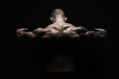 Unrecognizable man shows strong neck muscles closeup Royalty Free Stock Photography