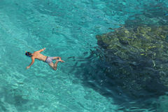 Unrecognizable man snorkeling in water in Lefkada, Greece Stock Image