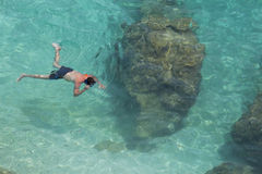 Unrecognizable man snorkeling in water in Lefkada, Greece Stock Images