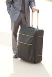 Unrecognizable man with suitcase. Royalty Free Stock Images