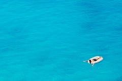 Unrecognizable man swimming at Porto Katsiki beach Stock Photos