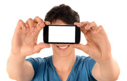 Unrecognizable man taking a selfie photo with his smart phone. Stock Photography