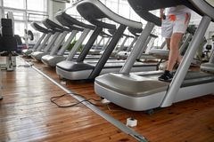 Unrecognizable man on treadmill during his training in gym. stock photography