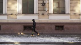 Unrecognizable man walking in the city stock footage