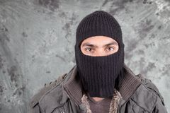Unrecognizable man wearing black hoodie over grey Royalty Free Stock Image